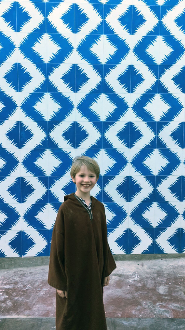 Lucien-in-front-of-Poham-Design-cement-tile-wall