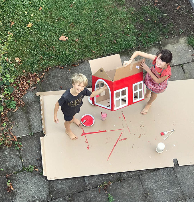 Kids-painting-a-house-for-their-cat